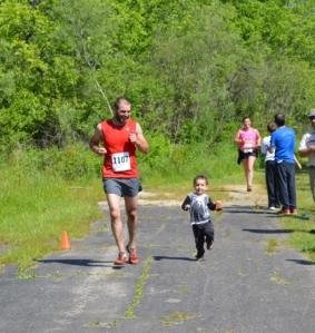 Paavo ran with Jesse across the finish line. Jesse was 3rd in his age group!